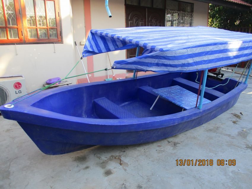 Small plastic/polyethylene boat with canopy and some extras
