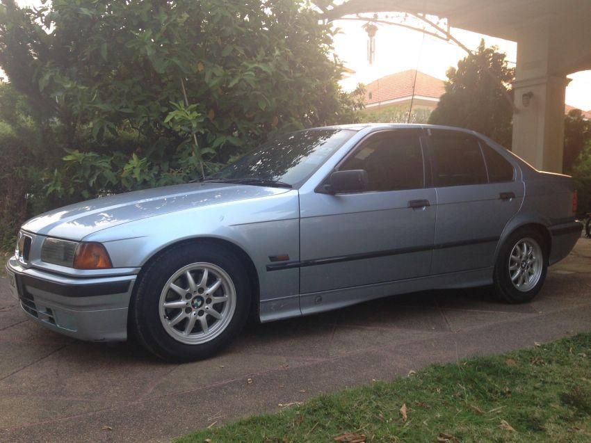 Light Blue BMW E36 320i (1991)