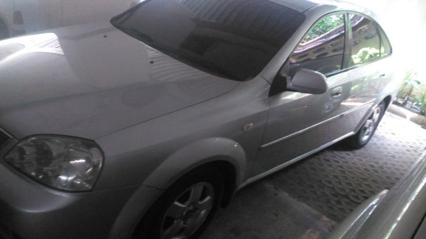 Chevrolet Optra 4 door.Exchange for Pick-up truck