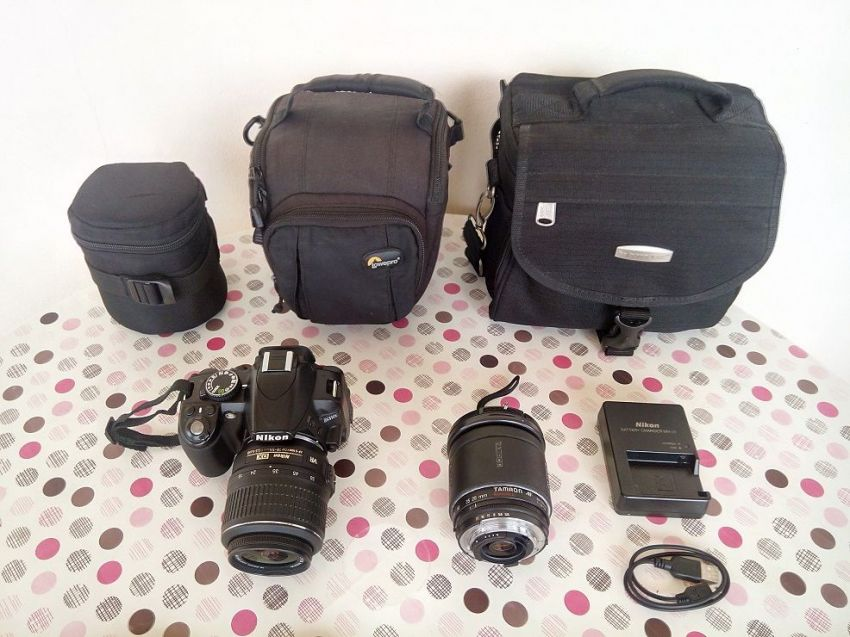 Nikon D3100 Body With Nikon 18-55mm. Lens and Tamron 28-200mm. Lens + Extra Filters and Bags