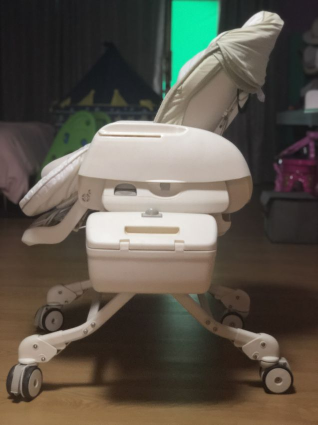 Combi auto swing high chair/bed