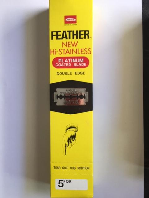 Unopened box of 100 Feather platinum-coated, double-edge razor blades.