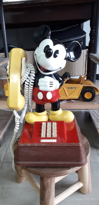 This is a beautiful Mickey Mouse push button phone and wrist watch