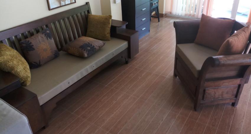 Hardwood set of 1 sofa 1 armchair with cushion.