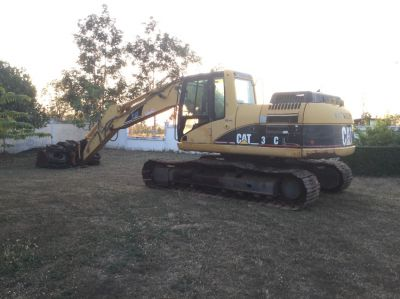 Cat 318cl w/- quick hitch and extra batter bucket