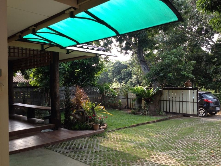 A fully furnished wooden Thai style house with nice and green garden