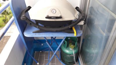 Weber grill with gas bottle and table