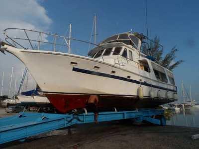 47 ft flybridge cruiser/power boat, a well-proven cruising vessel.