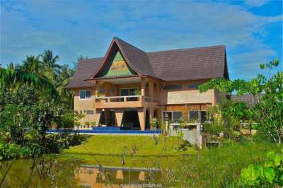 Large estate with pond for sale