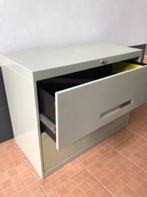 Metal Filing Cabinet Lateral with hanging folders, good condition.