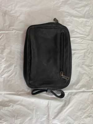 Tumi clutch/travel bag, new condition.