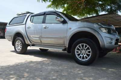 Mitsubishi Triton CNGLong range 350-400km  fitted with three tanks.