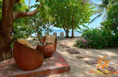 Fantasic long etablished beach property for a real bargain price