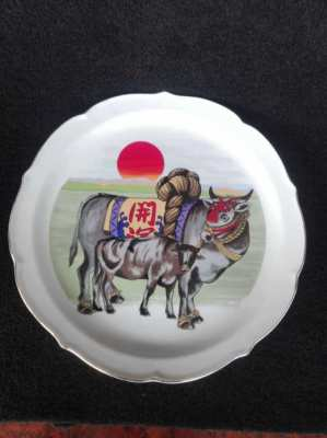Collectible ceramic plate with cows.