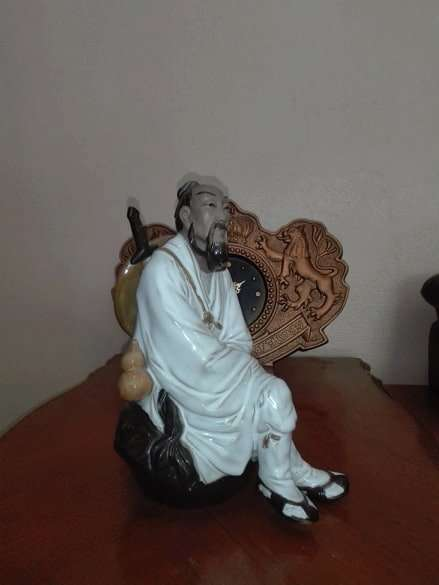 SOLD!!! Black clay sculpture of Relaxed man
