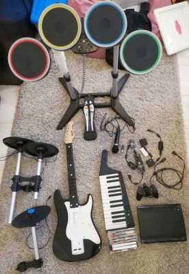 PS3 Rockband Set: console, drums, keys, discs, cables, etc