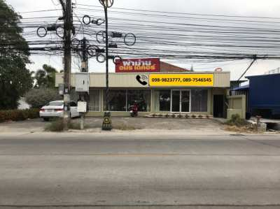 Land for sale with shops on Soi Siam Country Club Road