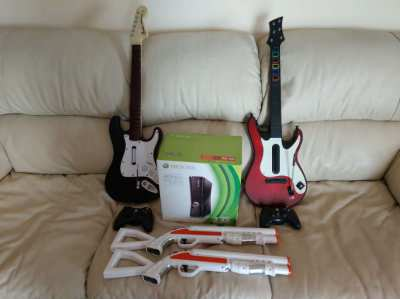 Xbox 360 with 2 guitars, 2 controllers, 2 guns and 50 games