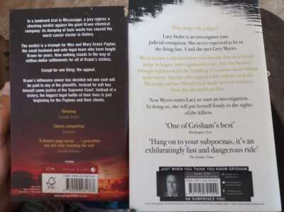 John Grisham; two paperbacks . . .