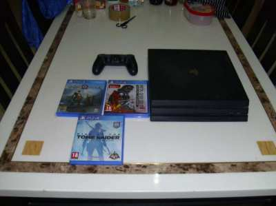 PS4 Playstation 4 console with 3 games