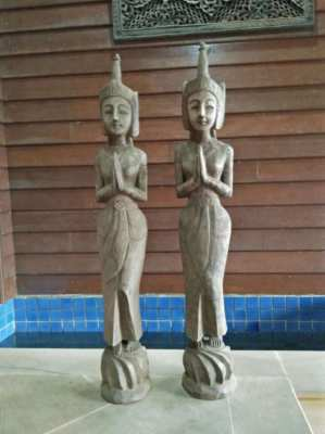 Old wooden carved statues reduced.