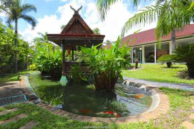 Spacious property in a secured village with pool and fish pond