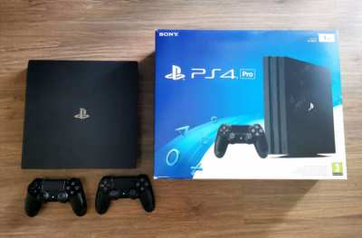 Sony PS4 PRO 1TB jet black (2 original dualshock gamepad included)