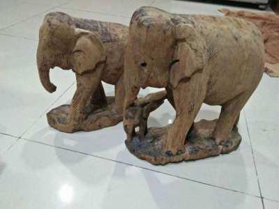 Old carved teak wood elephants