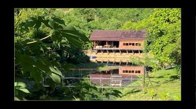 64 Rai - large lake - island - wooden houses - hot spring.