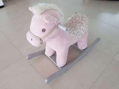Stuffed rocking horse - action toy