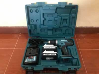 Makita Drill (model number DF457D) with 2 batteries