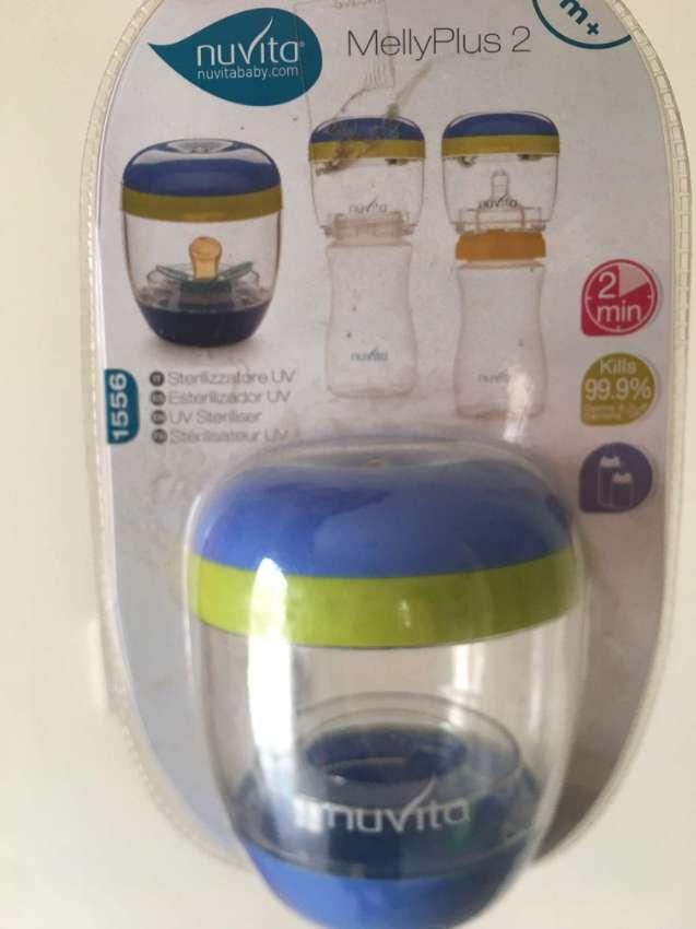 Baby UV-bottle-sterilizer, feeding bottle and pacifier, all new!