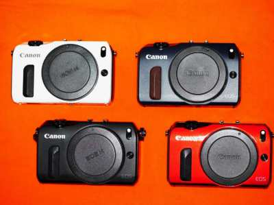 Canon EOS M Black, White, Red and Blue bodies.