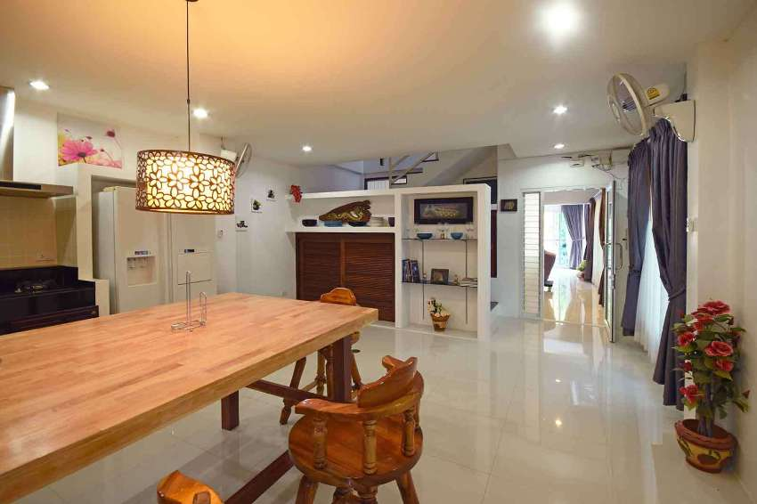 A three-story, fully-furnished town house style property located jus