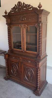 Antique carved hunting cabinet