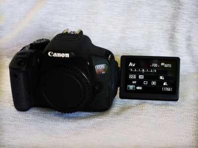 Canon Kiss X7i (Canon EOS 700D Rebel T5i) DSLR Black Body.