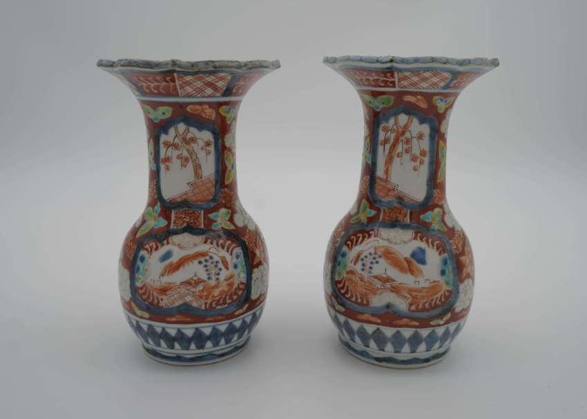 A pair of Japanese Meiji Imari porcelain vases