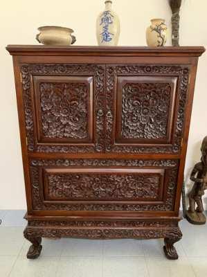 Heavily carved Thai teak cabinet