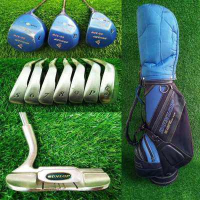 Full set of Dunlop golf clubs in bag.