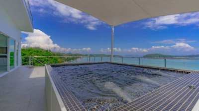 Two waterfront villas for sale.