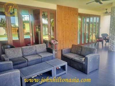 A modern, 3/4 bedroom pool villa for sale in Hua Hin.