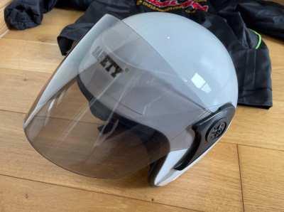 Helmet (brand new, never used) and rain coat