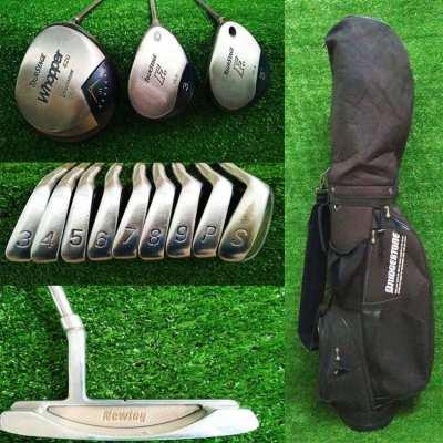 Complete set of Bridgestone golf clubs in bag.