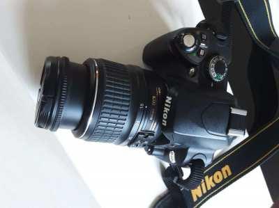 Nikon D40x DSLR camera with 2 Nikon zoom lenses