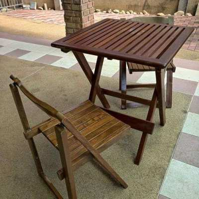 Solid wood folding table with two solid wood folding chairs