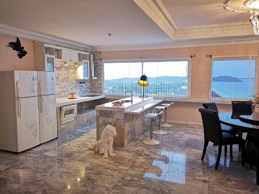 Exclusive topfloor penthouse beach condo in New World Condo.