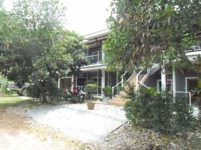 Land & apartment building for sale