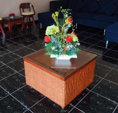 Teak and Wicker Glass Topped Coffee Table